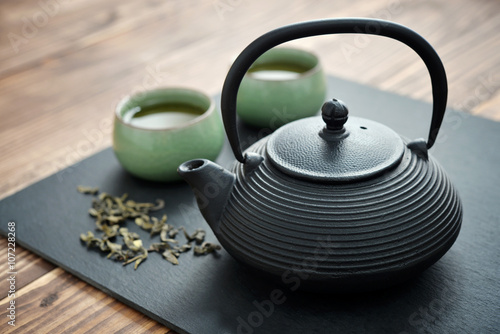Fototapeta Green tea in cast-iron teapot