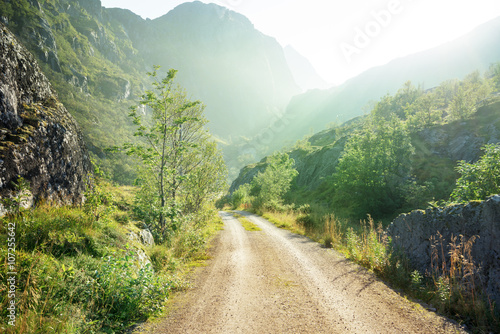 ground road in mountain, Lofoten islands, Norway - 107255642