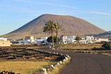 Village and volcano in early morning light. Lanzarote, San Canary Islands, Spain. In the inland near San Bartolome and La Geria.