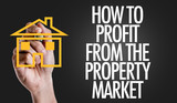 Hand writing the text: How To Profit From The Property Market