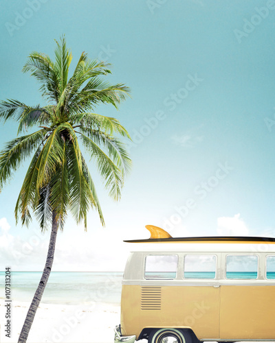 Vintage car parked on the tropical beach (seaside) with a surfboard on the roof - 107313204