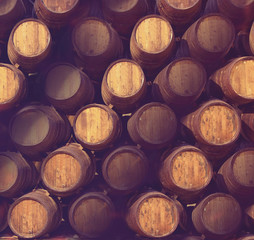 Row of wooden barrels of tawny portwine ( port wine ) in cellar, Porto, Portugal. Vintage old style