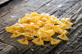 Heap of farfalle pasta, on wooden surface