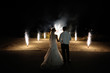 Bride and groom on the background of wedding fireworks