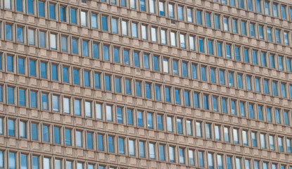 A huge office building wall with windows