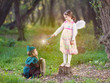 Obrazy na płótnie, fototapety, zdjęcia, fotoobrazy drukowane : Cute little children dressed up as a fairy and a knight playing in a dreamlike nature