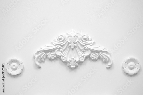 Stucco elements on white wall - 107383481
