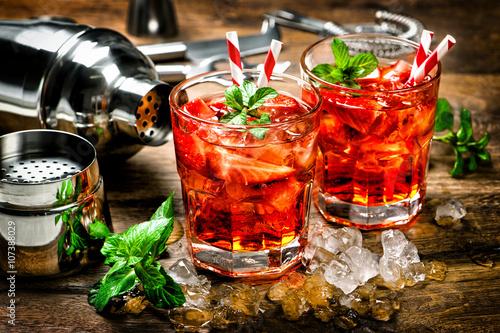 Fototapeta Red drink. Cocktail making bar accessories vintage