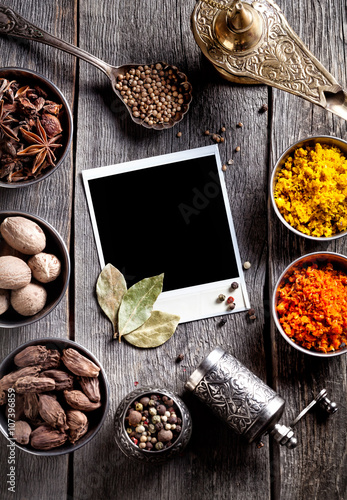 Poster Spices and blank photo at the table