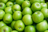 Apple. Green background.