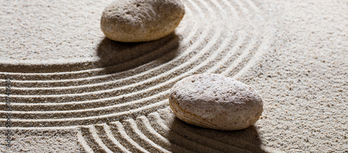 Foto op Canvas Stenen in het Zand zen sand still-life - stones set across sinuous waves for concept of different directions or change with inner peace