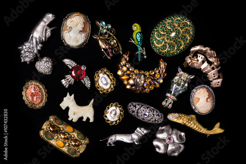 Poster Antique and vintage jewelry collection isolated on a black background