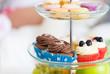 Obrazy na płótnie, fototapety, zdjęcia, fotoobrazy drukowane : close up of cake stand with cupcakes and cookies