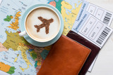 Fototapety Aircraft made ofcinnamon in cappuccino, passports and boarding passes with Europe map. Travel concept