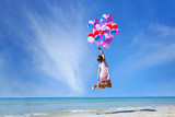 dream concept, girl flying on multicolored balloons in blue sky, imagination and creativity - 107482401