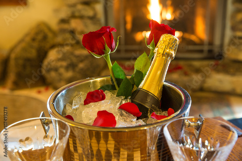romantic room with champagne bucket and roses