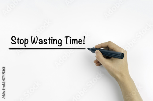 Hand with marker writing: Stop Wasting Time! Poster