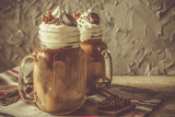 Fototapety Cold coffee drink in glass jar