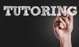Fototapety Hand writing the text: Tutoring