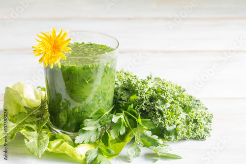 Green smoothie with dandelion healthy lifestyle concept