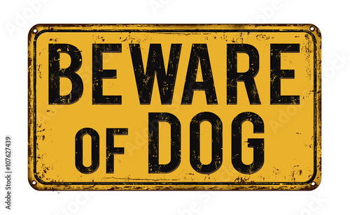 Beware of dog on yellow vintage rusty retro sign