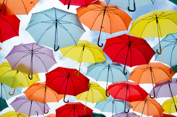 Colorful umbrellas floating © Alfonsodetomas