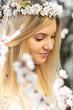 Obrazy na płótnie, fototapety, zdjęcia, fotoobrazy drukowane : Spring portrait of woman among flowering branches