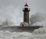 Old lighthouse under heavy storm