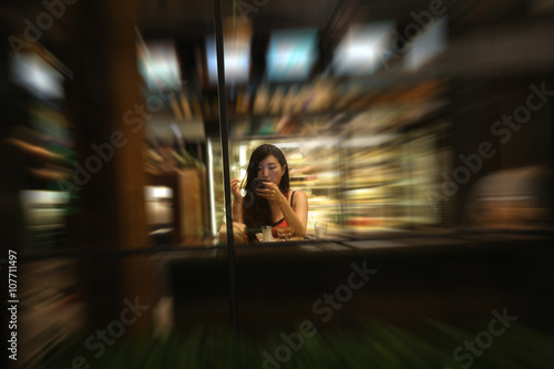 blurred women use phone in coffee shop Poster