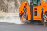 "Road roller flattening new asphalt 93526522,Woman fastening her bike helmet"""