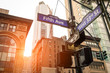 Street sign of Fifth Ave and West 33rd St at sunset in New York City - Manhattan district urban area