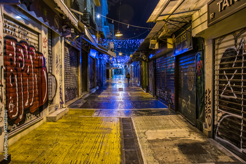 night view of an empty street in Plaka which is the old historical neighborhood of Athens, clustered around the northern and eastern slopes of the Acropolis.