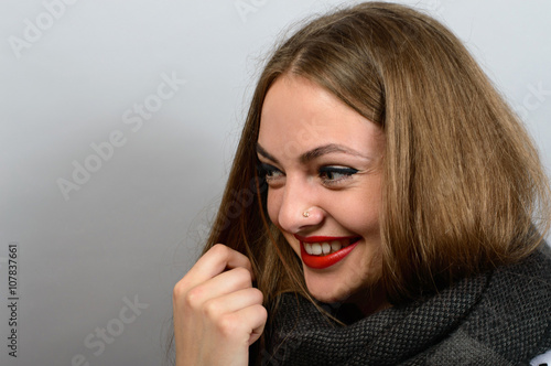 Smiling Woman in scarf, looks like angelina jolie Poster