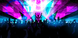 Fototapety Electronic dance music festival with dancing people.