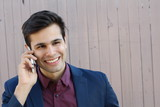 Portrait of young businessman talking on the phone