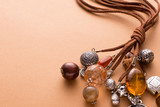 Necklace Made with Brown Leather and Silver Charms