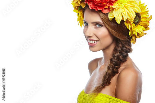 Beautiful Young Woman with Summer  Flowers. Long Permed Curly Ha