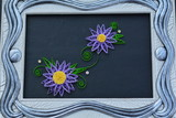 Purple, quilling flowers on the picture - handmade