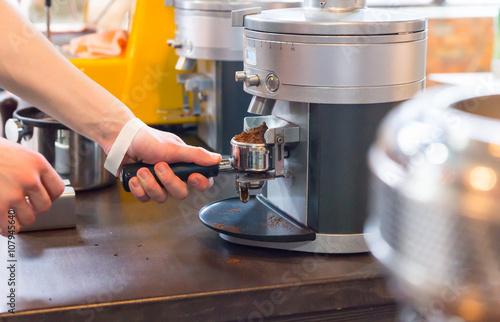 Papiers peints Café en grains Person grinding beans for fresh coffee