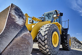 Heavy equipment machine wheel loader on construction jobsite - 107982085
