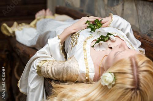 Plakat Sleeping beauty lying on the table