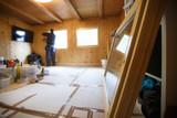 Worker installing new wooden windows