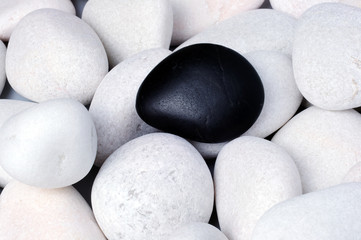 Being different, stand out of a crowd conceptual, zen stones with words