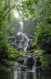 Fototapety Panoramic view of a waterfall flowing in the middle of the forest in Cerro Dantas natural reserve in Costa Rica