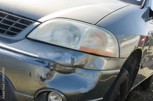 Damaged car close up. Accident concept Poster