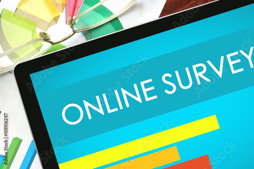 Online Survey written on a tablet. Web marketing concept.