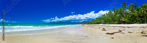 Port Douglas four mile beach and ocean on sunny day, Queensland,