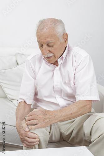 Elderly Man holds his knee Poster