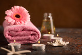 SPA still life with towel, candles and gerberas