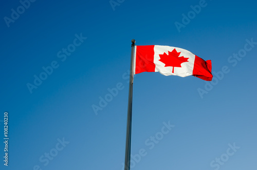 Aluminium Canada Canadian flag waving over blue sky